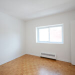 Bedroom with window and closet - unit 302 @ 60 Daly Ave.