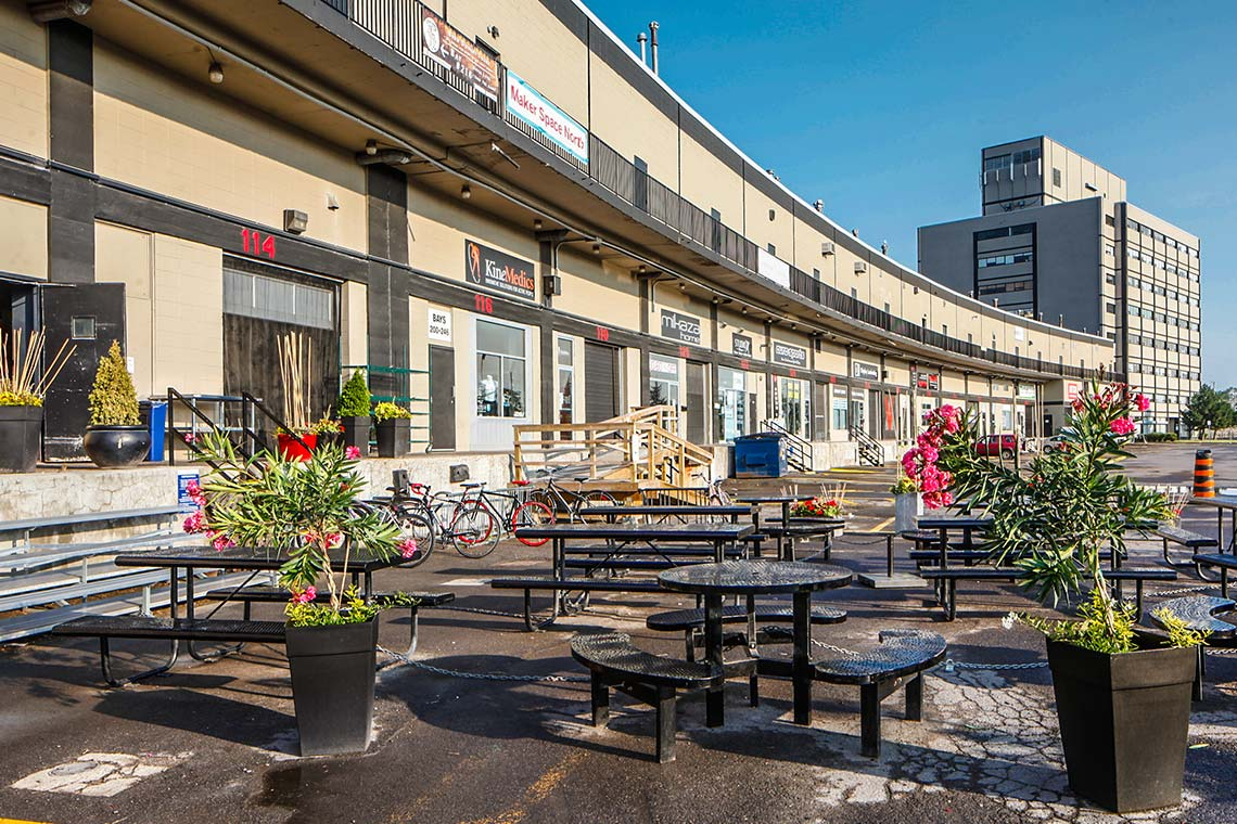 exterior seating outside ground level warehouse bays 250 city centre avenue