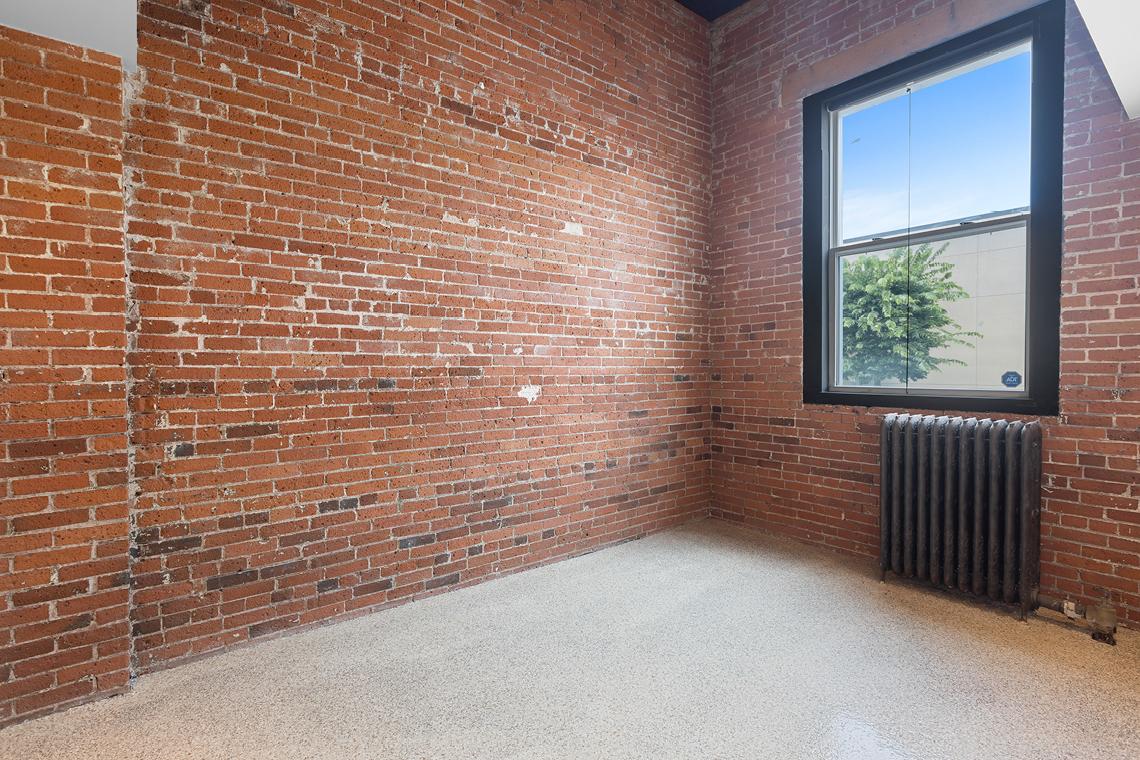 166 elm street interior windows and brick wall