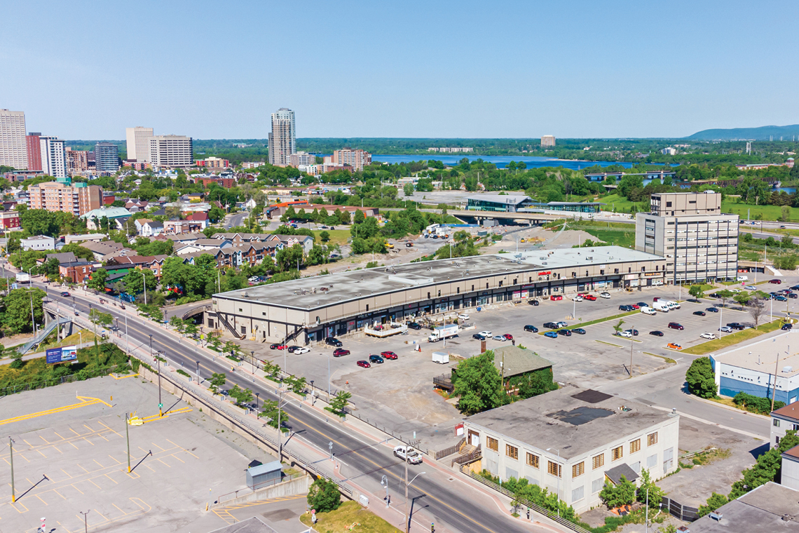 aerial photo of 250 City Centre Avenue facing west, bayview station and bridge to gatineau visible