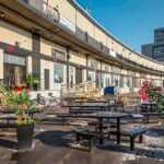 ground level warehouse bays with exterior seating 250 city centre